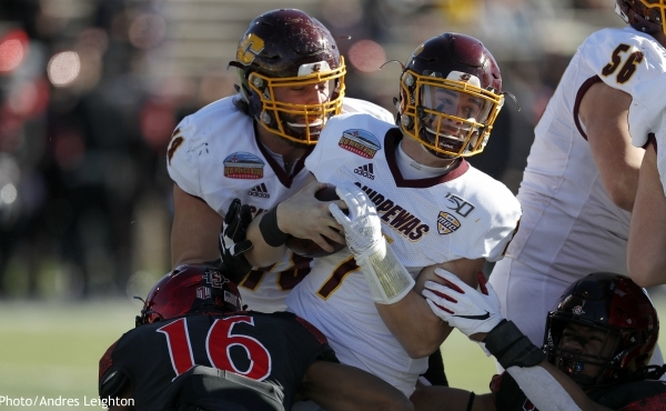 Central Michigan quarterback Tommy Lazzaro (7) is sacked by San Diego State cornerback Luq Barcoo (16) and defensive lineman Keshawn Banks (57) during the first half of the New Mexico Bowl NCAA college football game on Saturday, Dec. 21, 2019 in Albuquerque, N.M. (AP Photo/Andres Leighton)