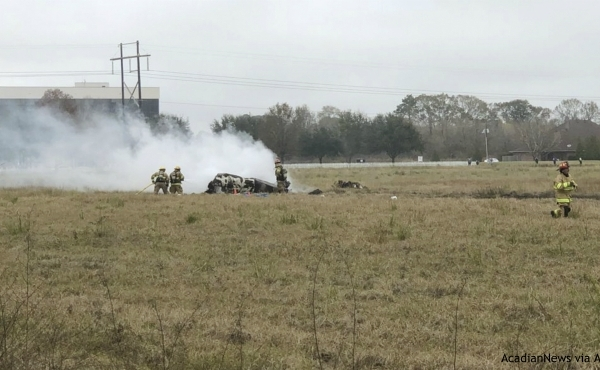 This photo provided by AcadianNews shows first responders looking over the site of a plane crash near Feu Follet Road and Verot School Road in Lafayette, La., Saturday, Dec. 28, 2019. Authorities confirmed the accident but details on whether anyone was injured was not immediately known. (AcadianNews via AP)