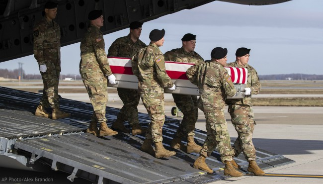 An Army carry team moves a transfer case containing the remains of U.S. Army Sgt. 1st Class Michael Goble, Wednesday, Dec. 25, 2019, at Dover Air Force Base, Del. (AP Photo/Alex Brandon)