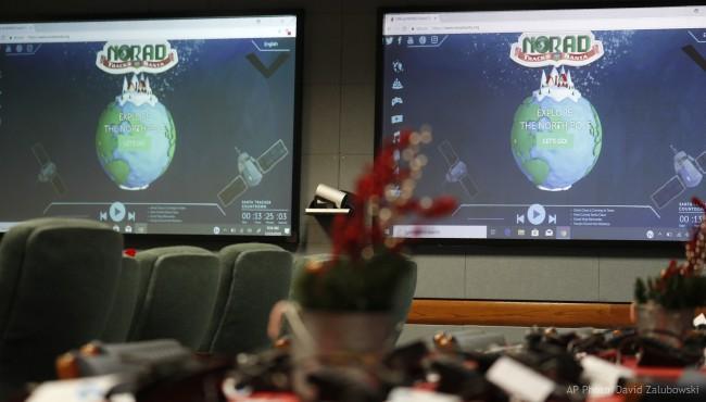 Monitors are illuminated in the NORAD Tracks Santa center at Peterson Air Force Base, Monday, Dec. 23, 2019, in Colorado Springs, Colo. (AP Photo/David Zalubowski)