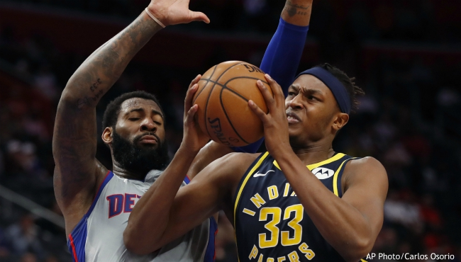 Indiana Pacers center Myles Turner (33) is defended by Detroit Pistons center Andre Drummond during the second half of an NBA basketball game Friday, Dec. 6, 2019, in Detroit. (AP Photo/Carlos Osorio)