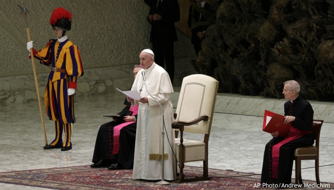Pope Francis delivers his message on the occasion of his Christmas greetings to Vatican employees, in the Pope Paul VI Hall, at the Vatican, Saturday, Dec. 21, 2019. (AP Photo/Andrew Medichini)