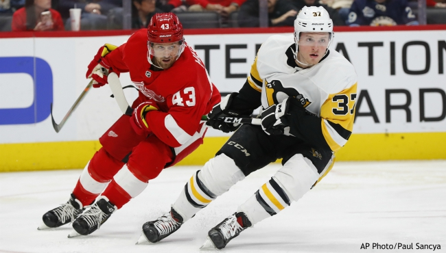 Detroit Red Wings left wing Darren Helm (43) and Pittsburgh Penguins center Sam Lafferty (37) chase the puck in the second period of an NHL hockey game Saturday, Dec. 7, 2019, in Detroit. (AP Photo/Paul Sancya)