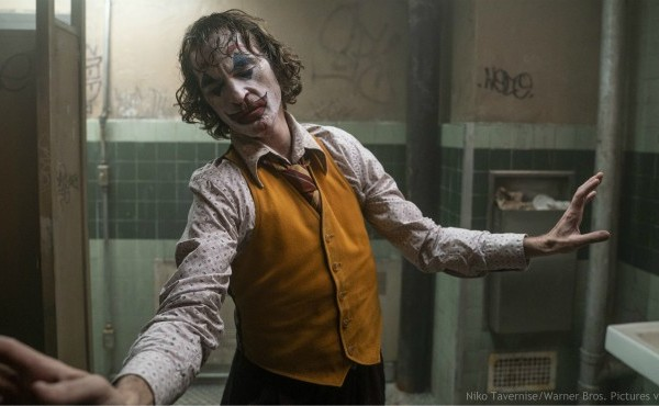 """This image released by Warner Bros. Pictures shows Joaquin Phoenix in a scene from """"Joker."""" (Niko Tavernise/Warner Bros. Pictures via AP)"""