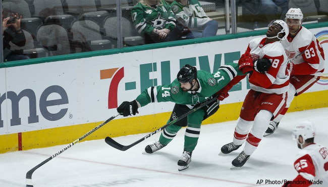 Dallas Stars forward Jamie Benn (14) battles Detroit Red Wings' Givani Smith (48) for space during the third period of an NHL hockey game Friday, Jan. 3, 2020, in Dallas. (AP Photo/Brandon Wade)