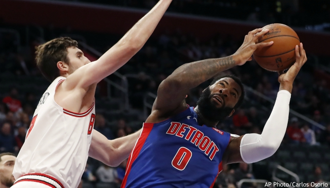hicago Bulls forward Luke Kornet, left, defends as Detroit Pistons center Andre Drummond (0) attempts to shoot during the first half of an NBA basketball game, Saturday, Jan. 11, 2020, in Detroit. (AP Photo/Carlos Osorio)