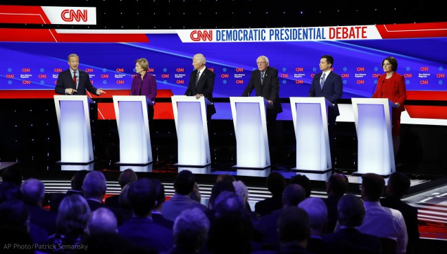 From left, Democratic presidential candidates businessman Tom Steyer speaks as, Sen. Elizabeth Warren, D-Mass., former Vice President Joe Biden, Sen. Bernie Sanders, I-Vt., former South Bend Mayor Pete Buttigieg, and Sen. Amy Klobuchar, D-Minn. listen Tuesday, Jan. 14, 2020, during a Democratic presidential primary debate hosted by CNN and the Des Moines Register in Des Moines, Iowa. (AP Photo/Patrick Semansky)