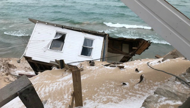 white river township house fallen off bluff