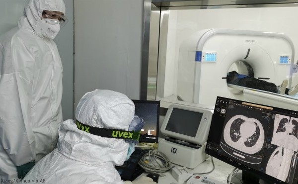 In this Sunday, Feb. 9, 2020, photo released by Xinhua News Agency, doctors scan a patient's lungs at Huoshenshan temporary hospital built for patients diagnosed with coronavirus in Wuhan in central China's Hubei province. (Gao Xiang/Xinhua via AP)