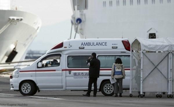 An ambulance arrives at the cruise ship Diamond Princess anchored at Yokohama Port in Yokohama, near Tokyo. Friday, Feb. 7, 2020. (AP Photo/Eugene Hoshiko)