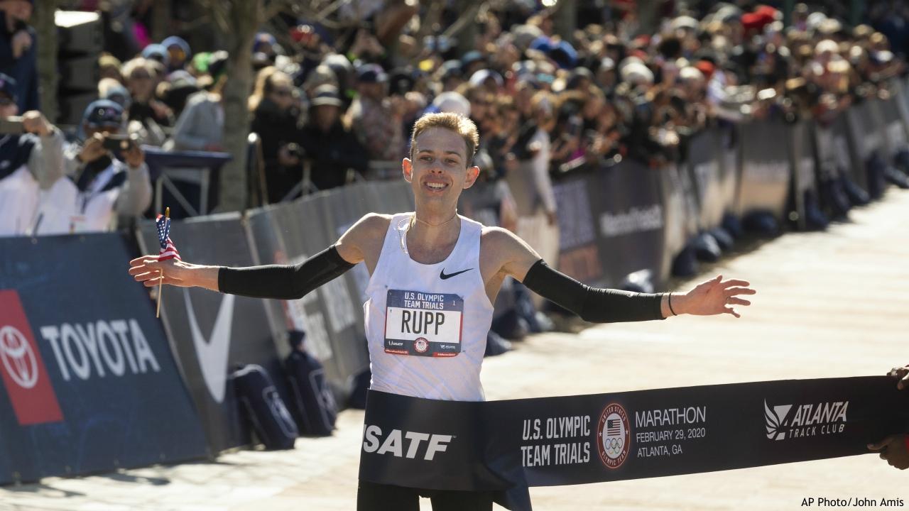 Galen Rupp crosses the finish line to win the U.S. Olympic marathon trials, Saturday, Feb. 29, 2020, in Atlanta. (AP Photo/John Amis)