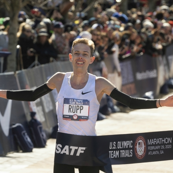 Galen Rupp crosses the finish line to win the U.S. Olympic marathon trials, Saturday, Feb. 29, 2020, in Atlanta. (AP Photo/John Amis)