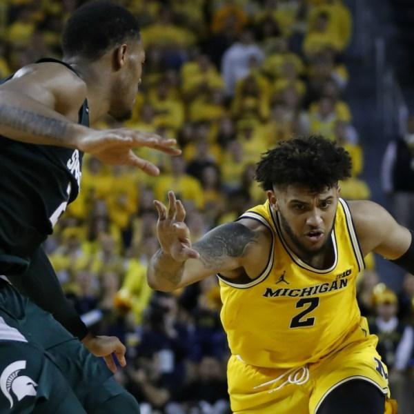 Michigan forward Isaiah Livers (2) drives on Michigan State forward Xavier Tillman (23) in the second half of an NCAA college basketball game in Ann Arbor, Mich., Saturday, Feb. 8, 2020. (AP Photo/Paul Sancya)