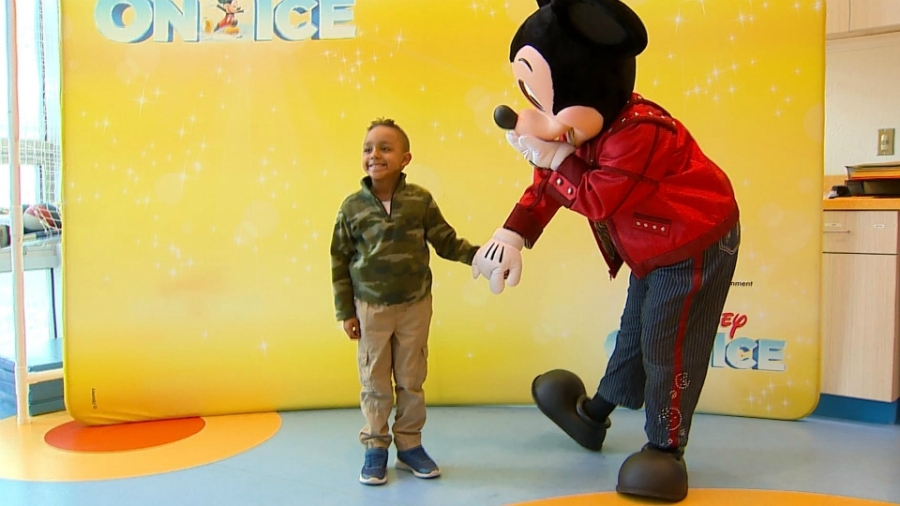 Mickey Mouse greets a child at Helen DeVos Children's Hospital in Grand Rapids on Feb. 26, 2020.