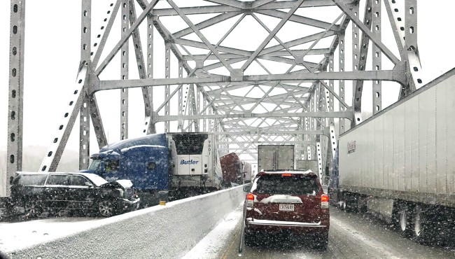 In this photo released by the Missouri State Highway Patrol, a multi-vehicle pileup on Interstate 70 on the bridge that spans the Missouri River near Rocheport, Mo., is shown during a winter storm, Wednesday, Feb. 5, 2020. (Missouri State Highway Patrol via AP)