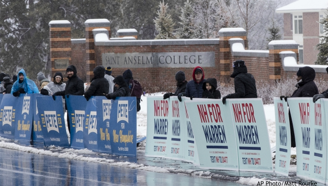 Supporters of Democratic presidential candidate former South Bend, Ind., Mayor Pete Buttigieg and Democratic presidential candidate Sen. Elizabeth Warren, D-Mass., gather outside Saint Anselm College, Friday, Feb. 7, 2020, ahead of a Democratic party debate in Manchester, N.H. (AP Photo/Matt Rourke)