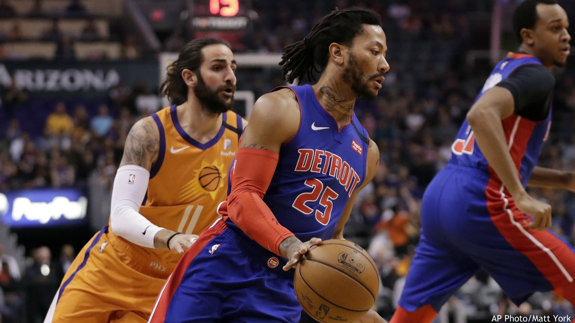 Detroit Pistons guard Derrick Rose (25) slips past Phoenix Suns guard Ricky Rubio (11) during the first half of an NBA game, Friday, Feb. 28, 2020, in Phoenix. (AP Photo/Matt York)