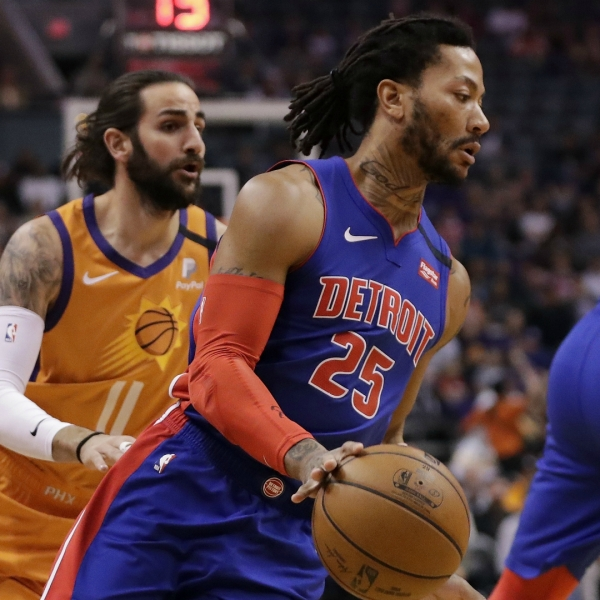 Detroit Pistons guard Derrick Rose (25) slips past Phoenix Suns guard Ricky Rubio (11) during the first half of an NBA game, Friday, Feb. 28, 2020, in Phoenix. (AP Photo/Matt York)