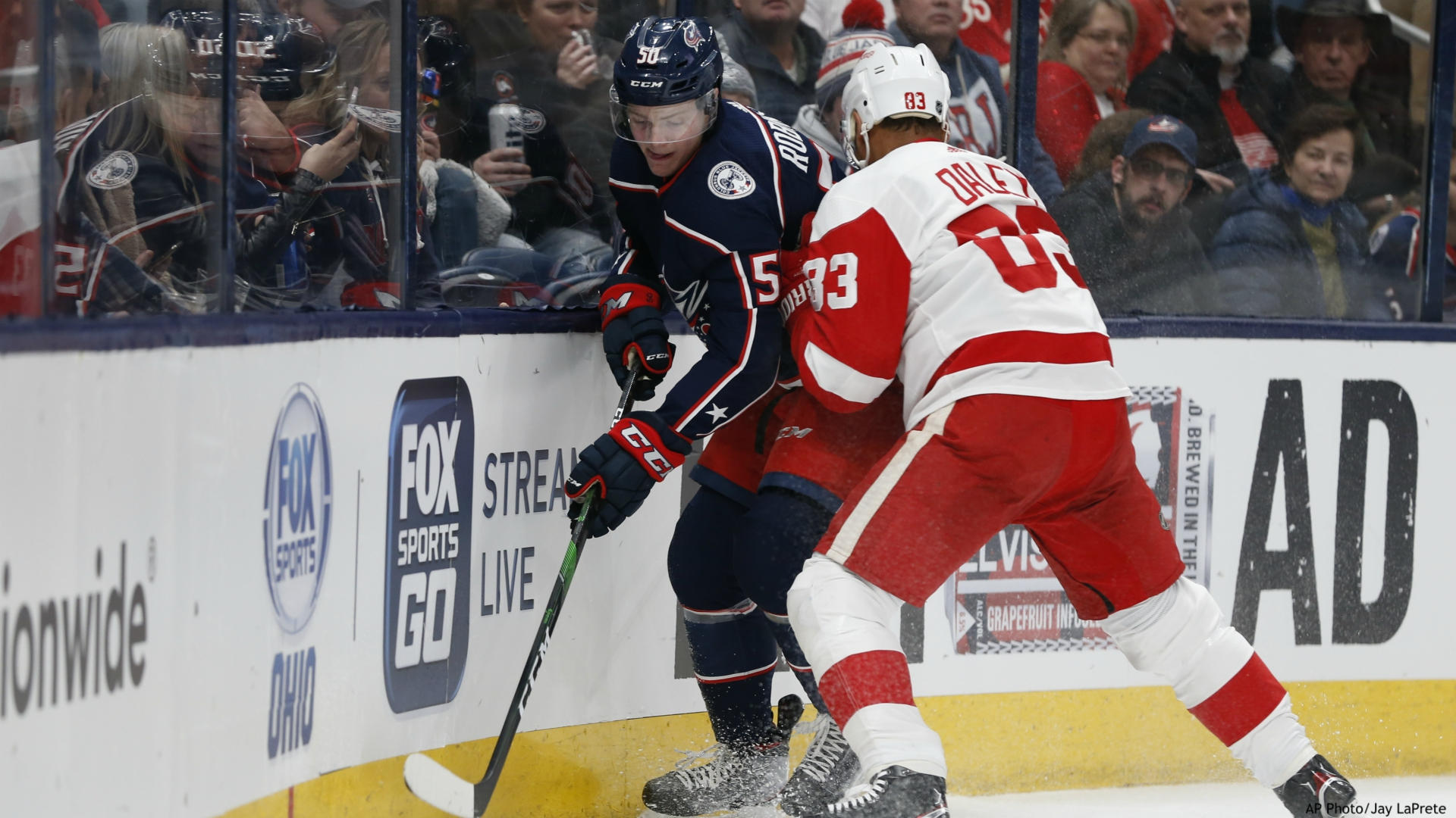 Columbus Blue Jackets' Eric Robinson, left, controls the puck as Detroit Red Wings' Trevor Daley defends during the second period of an NHL hockey game Friday, Feb. 7, 2020, in Columbus, Ohio. (AP Photo/Jay LaPrete)