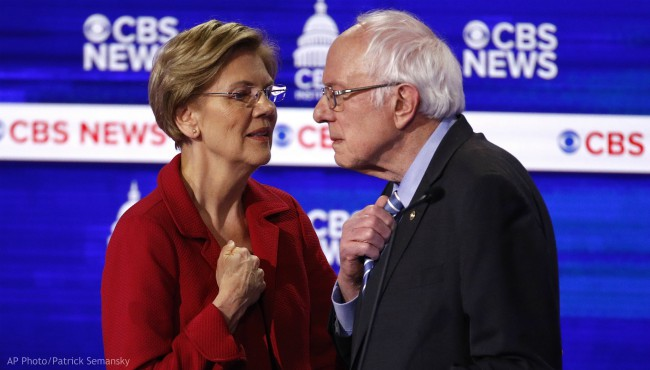 From left, Democratic presidential candidates, Sen. Elizabeth Warren, D-Mass., talks with Sen. Bernie Sanders, I-Vt., during a Democratic presidential primary debate at the Gaillard Center, Tuesday, Feb. 25, 2020, in Charleston, S.C., co-hosted by CBS News and the Congressional Black Caucus Institute. (AP Photo/Patrick Semansky)