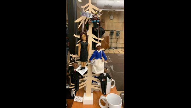 A courtesy photo of a gift shop display featuring dolls depicting prominent black figures. The tree has been removed. (Courtesy of Krystal Davis-Dunn)