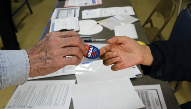 Early voter receives his I-Voted sticker, at an early voting polling station at the Ranchito Avenue Elementary School in the Panorama City section of Los Angeles on Monday, March 2, 2020. (AP Photo/Richard Vogel)