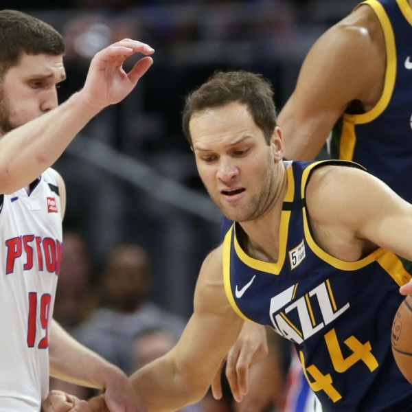 Utah Jazz forward Bojan Bogdanovic (44) drives against Detroit Pistons guard Sviatoslav Mykhailiuk (19) during the first half of an NBA basketball game Saturday, March 7, 2020, in Detroit. (AP Photo/Duane Burleson)