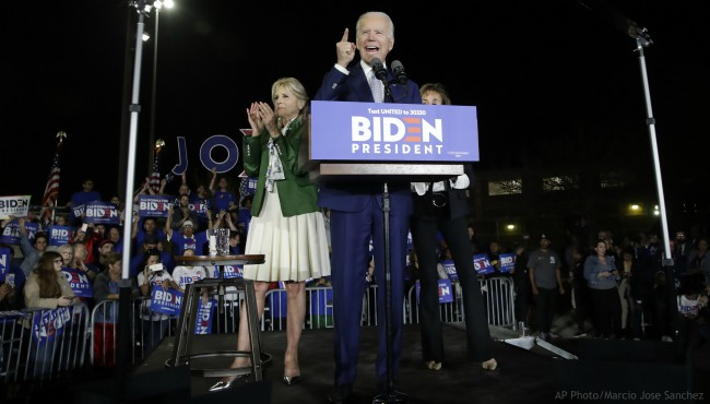 Democratic presidential candidate former Vice President Joe Biden speaks, next to his wife Jill during a primary election night rally Tuesday, March 3, 2020, in Los Angeles. (AP Photo/Marcio Jose Sanchez)