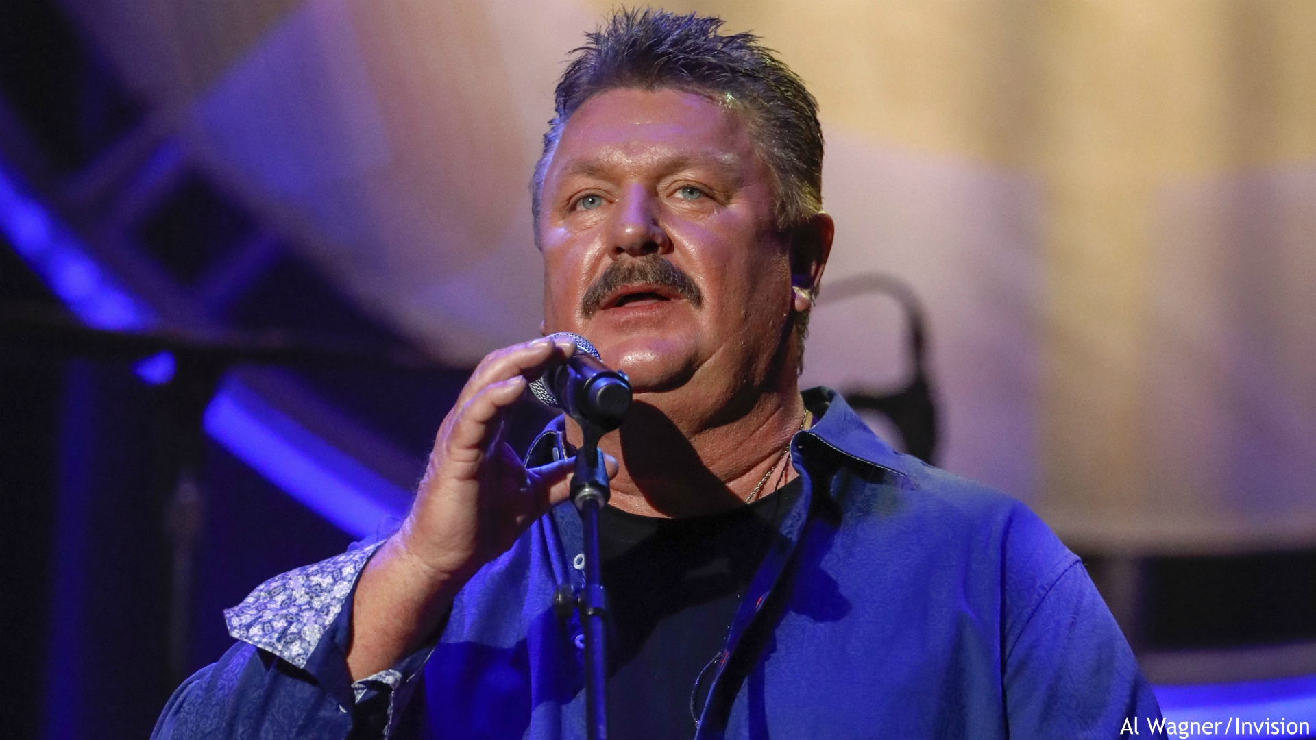 This Aug. 22, 2018 file photo shows Joe Diffie performing at the 12th annual ACM Honors in Nashville, Tenn. A publicist for Diffie says the country singer has tested positive for COVID-19. Diffie is under the care of medical professionals and is receiving treatment. (Photo by Al Wagner/Invision/AP, File)