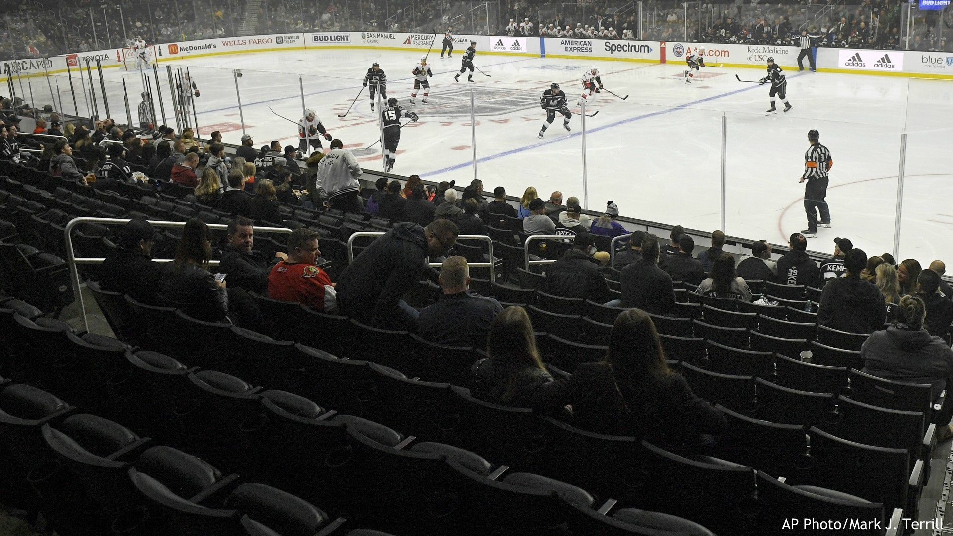 Empty seats are seen at the start of an NHL hockey game between the Los Angeles Kings and the Ottawa Senators on Wednesday, March 11, 2020, in Los Angeles. (AP Photo/Mark J. Terrill)