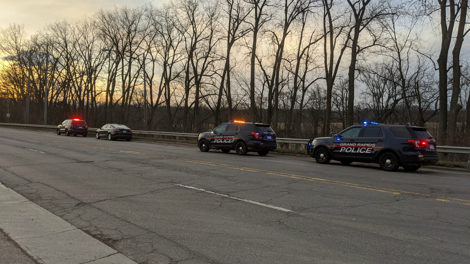 Grand Rapids officers pull a body out of the Grand River on March 25, 2020.