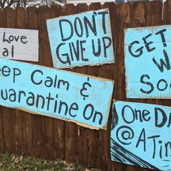 A homeowner on Oakland Drive in Portage decorated their fence with signs of encouragement on March 24, 2020.