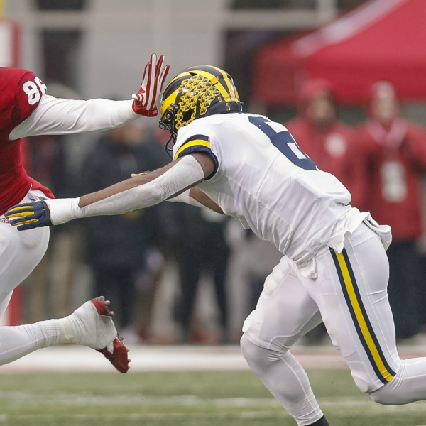 BLOOMINGTON, IN - NOVEMBER 23: Peyton Hendershot #86 of the Indiana Hoosiers gives the stiff arm as Josh Uche #6 of the Michigan Wolverines reaches for the tackle during the first half at Memorial Stadium on November 23, 2019 in Bloomington, Indiana. (Photo by Michael Hickey/Getty Images)