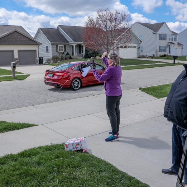 The Wyoming police and fire departments, along with family and friends, did a parade for Kenzie Gillett's 8th birthday on April 14, 2020. She was joined by her parents, Jason and Stephanie Gillett and her brother, Flynn. (Michael Buck/WOOD TV8)