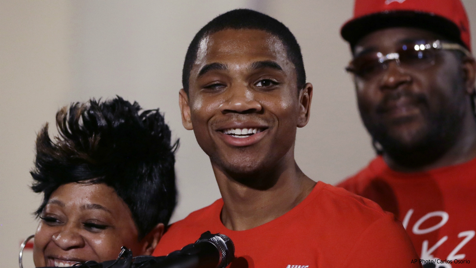 In this June 9, 2016, file photo, Davontae Sanford stands with his mother, Taminko Sanford, and addresses the media during a news conference in Detroit, a day after being released from prison. Michigan State Police said blood on the shoe of Davontae Sanford who was convicted but subsequently cleared of four murders reveals DNA from one of the victims. The disclosure was made in a recent filing in Detroit federal court where Davontae Sanford is suing Detroit police over the 2007 investigation. (AP Photo/Carlos Osorio, File)