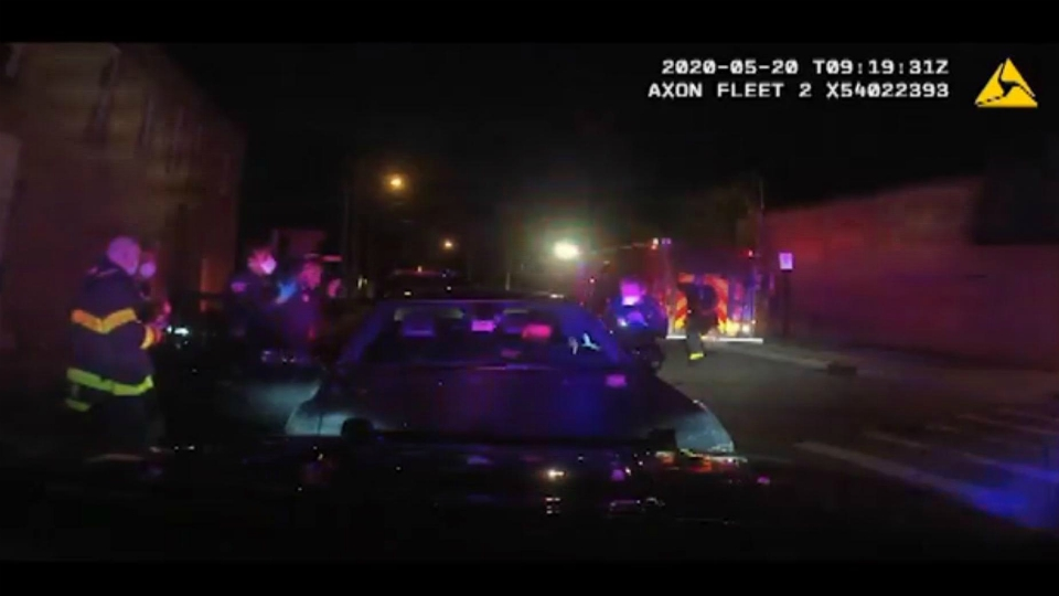 A screenshot of video of an incident at the intersection of South Division Avenue and Delaware Street SE on May 20 in Grand Rapids.