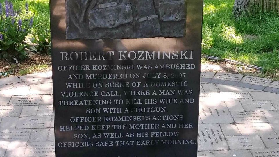 The defaced memorial for fallen Grand Rapids officer Robert Kozminski. (May 31, 2020)