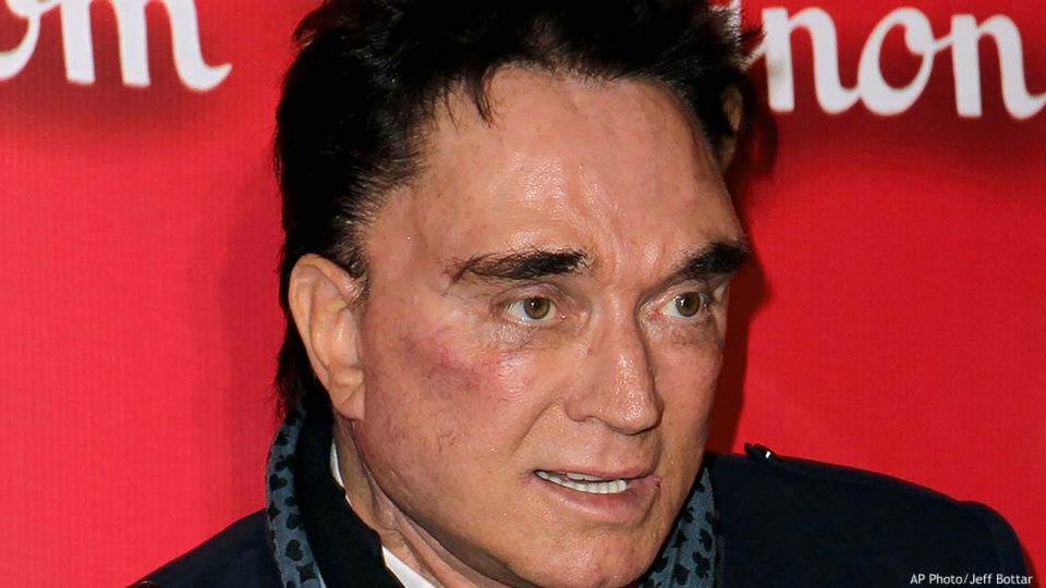 """In this Feb. 18, 2012, file photo, Roy Horn, of Siegfried & Roy, arrives at the Keep Memory Alive 16th Annual """"Power of Love Gala,"""" honoring Muhammad Ali with his 70th birthday celebration in Las Vegas. Horn, one half of the longtime Las Vegas illusionist duo Siegfried & Roy, died of complications from the coronavirus, Friday, May 8, 2020. He was 75. (AP Photo/Jeff Bottari, File)"""