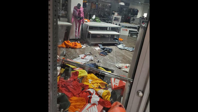 A courtesy photo of the Villa Clothing Store in downtown Grand Rapids after its front door was smashed during a riot on May 30, 2020.