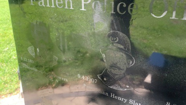 The defaced memorial for fallen Grand Rapids officers. (May 31, 2020)