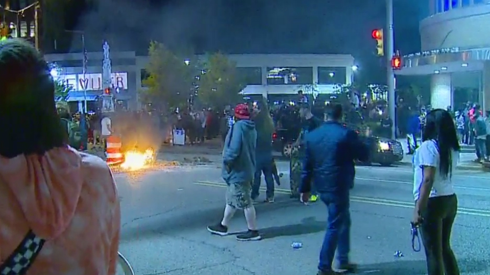 A fire in the middle of a street during a protest in downtown Grand Rapids on May 30, 2020.