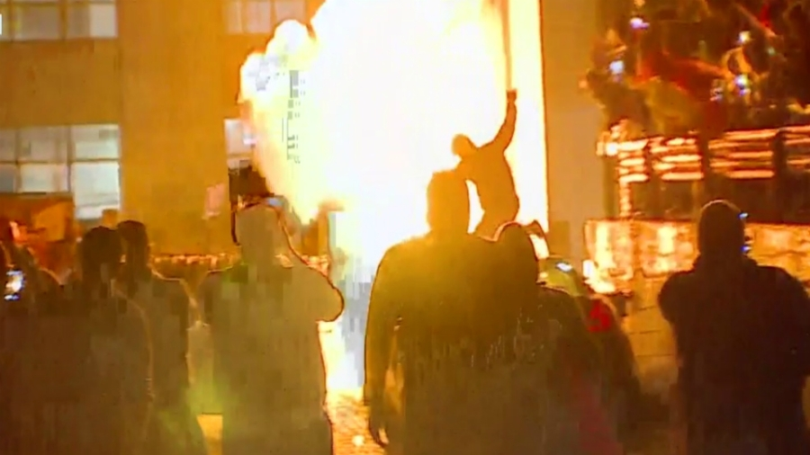 A fire during a protest in downtown Grand Rapids on May 30, 2020.