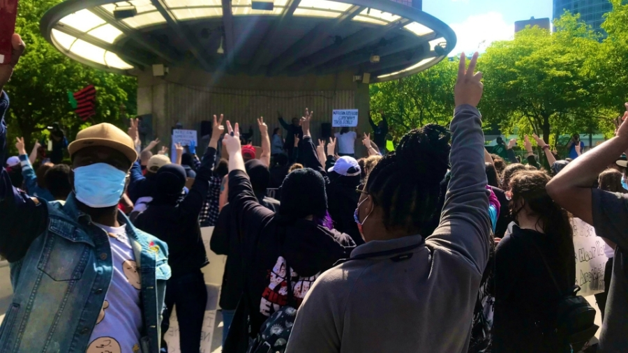 Protestors putting up the peace sign to symbolize their commitment to keep the peace during the demonstration in Grand Rapids on May 30, 2020.