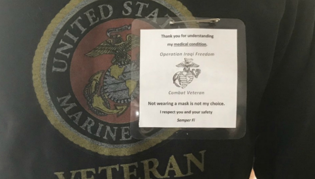 A West Michigan veteran wears a notice to explain why he can't wear a mask.