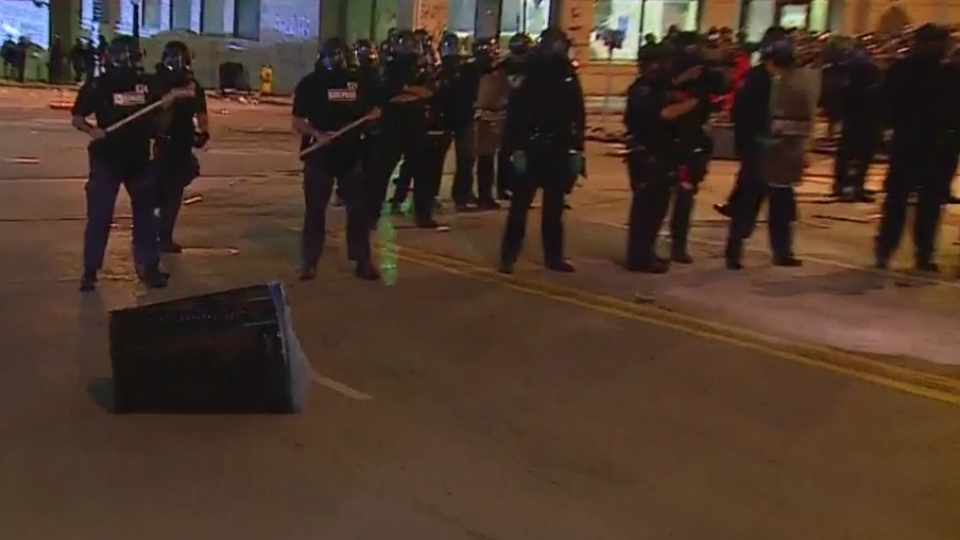 A trash can was thrown at police during a protest in Grand Rapids on May 30, 2020.