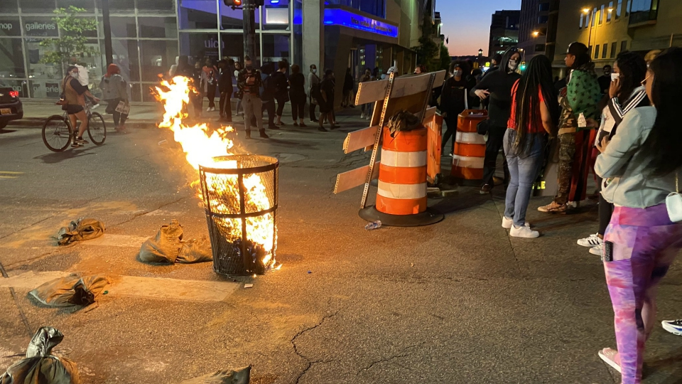 Trash can engulfed in flames in the street in Division Avenue and Fulton Street during a protest in Grand Rapids on May 30, 2020.