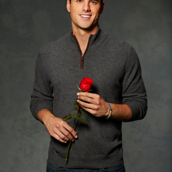 Ben higgins the Bachelor Season 11 lead holding one red rose and smiling in photo headshot