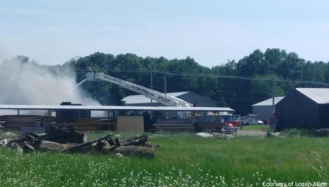 A photo of a fire at a building in Holland Township owned by the DeLeeuw Lumber Co. on June 27, 2020. (Courtesy of Logan Allen)