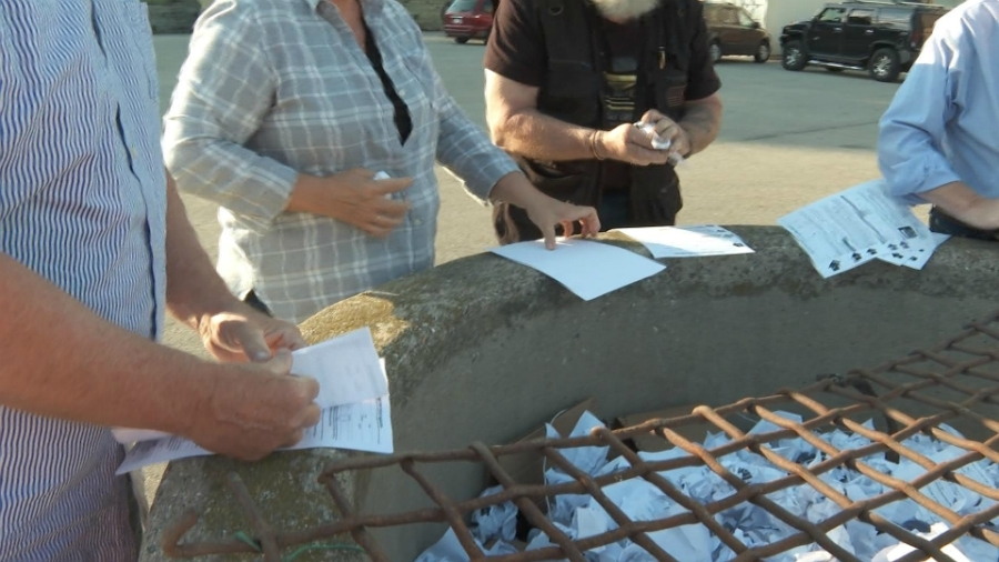 People burn absentee ballot applications at the DeltaPlex Arena in Walker on June 12, 2020.