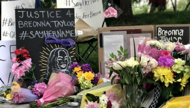 Signs at a vigil for Breonna Taylor in Grand Rapids on June 5, 2020.